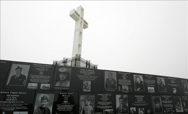 The Mount Soledad cross stands over memorials from the National War Memorial in Ja Jolla, California