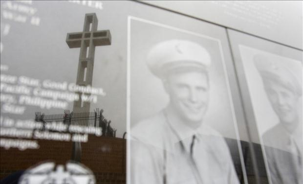 Mount Soledad Cross is seen in reflection on war memorial