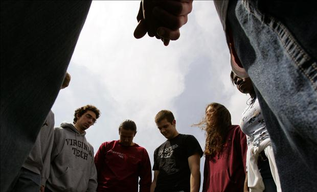 Virginia Tech students and others pray for the victims shot in the Virginia Tech tragedy during a group multi-denominational prayer meeting on the campus in Blacksburg