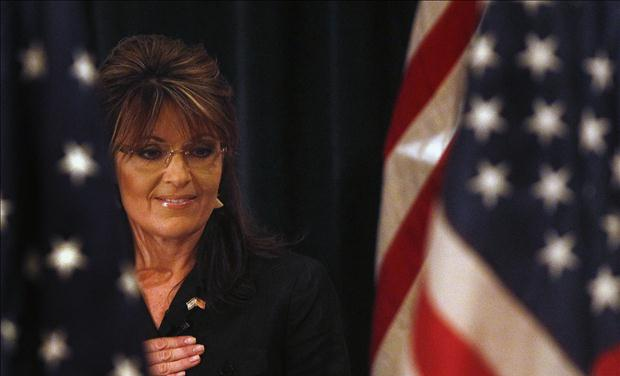 Former Alaska governor Sarah Palin looks down during the Pledge of Allegiance before speaking to the LIA Annual Meeting & Luncheon at the Crest Hollow Country Club in Woodbury