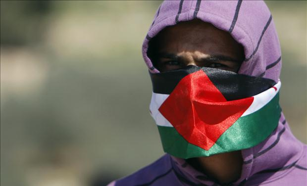 A Palestinian protester is seen during clashes at a protest in Bilin near Ramallah