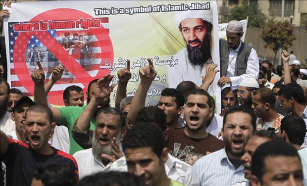 Islamists hold a picture of Osama bin Laden during a protest in Cairo
