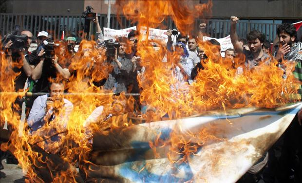 Demonstrators burn an Israeli flag during a protest in support of Palestinians, in front of the Israeli consulate in Istanbul
