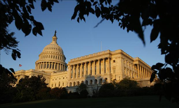 The U.S. Capitol is lit during sunset the day before mid-term elections in Washington