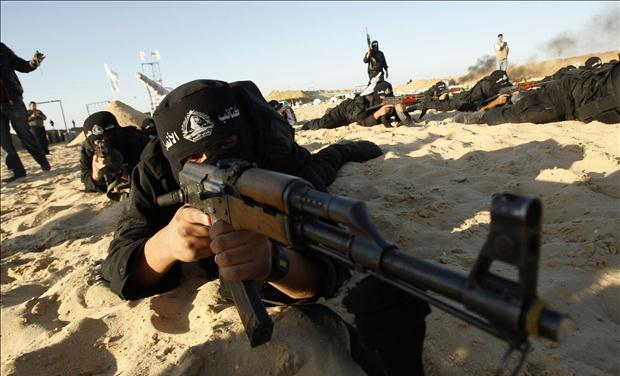 A Palestinian militant from Al-Ansar brigade takes part in a training session in Khan Younis in the southern Gaza Strip