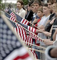 Local residents line the street as the funeral procession for Marine Lance Cpl. Walter O'Haire passes in Rockland
