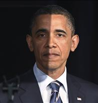 President Barack Obama pauses as seen through a teleprompter as he delivers a speech on U.S. fiscal and budgetary deficit policy at the George Washington University
