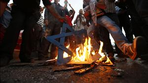 Hamas Supporters Burn Israeli Star of David