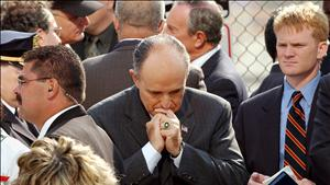 FORMER NEW YORK MAYOR GIULIANI PAUSES DURING CEREMONIES MARKING SEPTEMBER 11 ATTACKS.