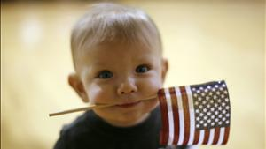 Baby Boy Carries US Flag
