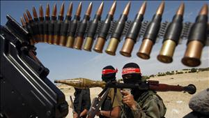 Palestinian militants of the Democratic Front for the Liberation of Palestine take part in a joint drill for the media in the Gaza Strip