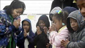 SCHOOLCHILDREN PRAY AT MAKESHIFT MEMORIAL TO THE COLUMBIA ASTRONAUTS IN HOUSTON.