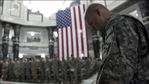 U.S. soldiers pray during a ceremony marking the 7th anniversary of the September 11 attacks in the United States, at the Al Faw palace in a U.S. military camp in Baghdad